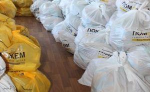 Гуманитарный штаб Рината Ахметова доставил продуктовые наборы для жителей Краснодонского района (фото)