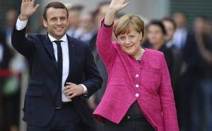 Макрон и Меркель выступили с призывом к Порошенко и Путину по Донбассу