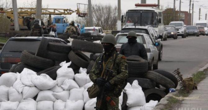 В 15 городах и районах Донецкой области продолжаются волнения, в том числе и вооруженные столкновения
