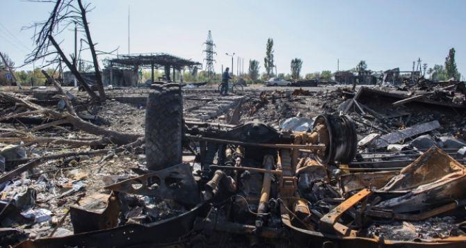 Боевые действия в Луганской области: последствия обстрела Лутугино +