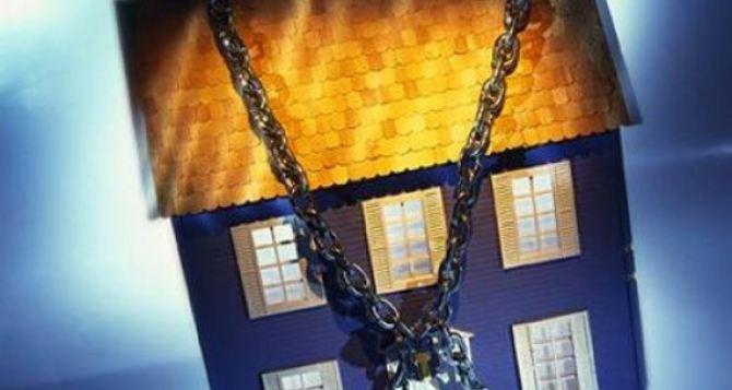 За коммунальные долги в Харькове отбирают квартиры