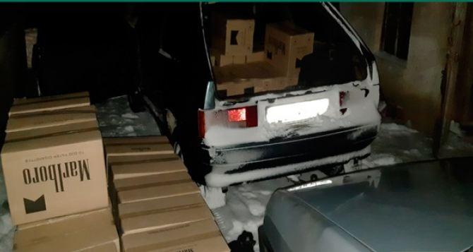 В Краснодоне и Красном Луче накрыли две крупные базы контрабандистов: изъяты 55 тысяч пачек сигарет и три автомобиля