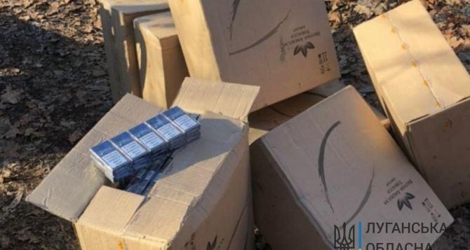 В районе Станицы Луганской через Северский Донец лодками переправляли сигареты из Луганска. ФОТО