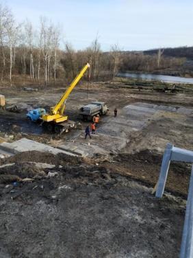 Чтобы не было беды, временный обходной мост на КПВВ «Станица Луганская» демонтировали. ФОТО